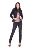 Casual woman pulling her jacket Stock Photography
