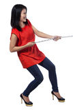 Casual woman is pulling silver chain royalty free stock photos