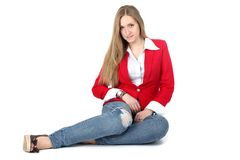 Casual woman in red coat smiling Stock Image