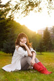 Casual woman relax in evening park Stock Images