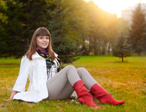 Casual woman relax in evening park Royalty Free Stock Image