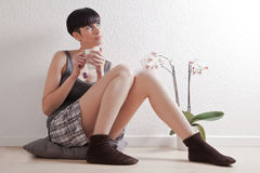 Casual woman relaxing at home Stock Image