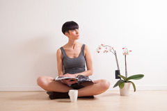 Casual woman relaxing at home Stock Photography