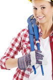 Casual woman in safety helmet and plumber wrench. Stock Image
