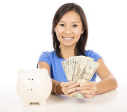 Casual woman saving money Royalty Free Stock Photos