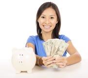 Casual woman saving money royalty free stock photos