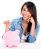 Casual woman saving money Stock Photography