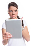 Casual woman scared with tablet Royalty Free Stock Image