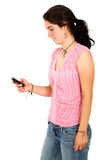 Casual woman sending an sms message Royalty Free Stock Images