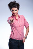 Casual woman in shirt and jeans pointing her finger Stock Image