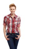 Casual woman in shirt and jeans smiling Stock Images