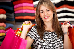 Casual woman with shopping bags Stock Images