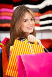 Casual woman with shopping bags Stock Photo
