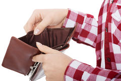 Casual woman showing her empty wallet. Royalty Free Stock Image