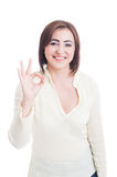 Casual woman showing perfect or good gesture and smiling Royalty Free Stock Photo