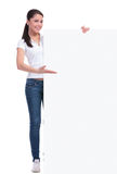 Casual woman shows big banner Royalty Free Stock Image