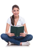 Casual woman sits with book Stock Photos