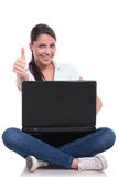 Casual woman sits with laptop & ok Royalty Free Stock Photos