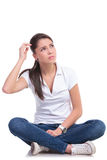 Casual woman sits puzzled Royalty Free Stock Photos