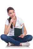 Casual woman sits & reads & thinks Royalty Free Stock Photos