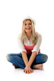 Casual woman sitting on the floor having fun Stock Image