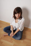 Casual woman sitting on floor Royalty Free Stock Photography
