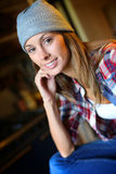 Casual woman sitting at home Stock Photography