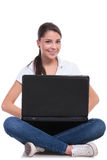 Casual woman sitting with laptop Royalty Free Stock Photo