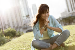Casual woman sitting outdoors Stock Images