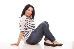 Casual woman sitting Stock Image