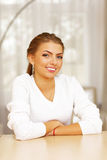 casual woman sitting at the table Royalty Free Stock Images