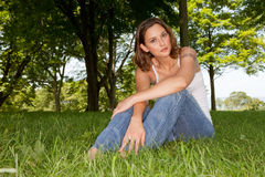 Casual Woman sitting On Well Manicured Grass Stock Image