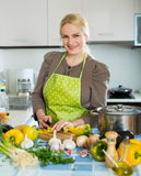 Casual woman slicing pepper Royalty Free Stock Image
