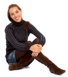 Casual woman smiling on the floor Royalty Free Stock Images