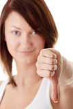 Casual woman smiling with her thumbs down Royalty Free Stock Photo