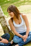 Casual woman smiling outdoors Royalty Free Stock Photography