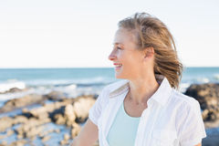 Casual woman smiling by the sea Stock Photo