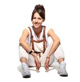 Casual woman smiling sitting on the floor Stock Images