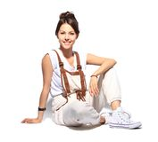 Casual woman smiling sitting on the floor Royalty Free Stock Photos
