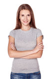 Casual woman smiling standing with folded hands Stock Images