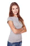 Casual woman smiling standing with folded hands Royalty Free Stock Photography