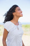 Casual woman smiling in the wind Royalty Free Stock Photos