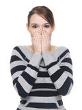 Casual woman - speak no evil. Isolate studio shot of a casually dressed young adult woman in the Speak No Evil pose Royalty Free Stock Photos