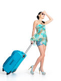 Сasual woman standing with travel suitcase Royalty Free Stock Photography