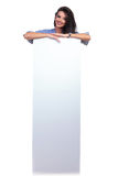 Casual woman stands behind board Royalty Free Stock Photo