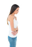 Casual woman with stomach pain and headache Royalty Free Stock Images