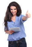 Casual woman with tablet shows thumb up Royalty Free Stock Photography