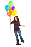 Casual: Woman Tries to Lose Weight By Holding Balloons Royalty Free Stock Image