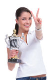 Casual woman with trophy & victory Stock Photos