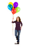 Casual: Woman Trying To Loose Weight With Balloons Stock Photo
